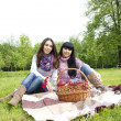 Mother and daughter relaxing outdoors — Stock Photo