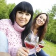 Mother and daughter drinking wine outdoors — Stock Photo