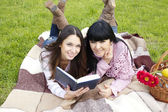 Mom and daughter reading a book — Stock Photo