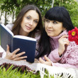 Mom and daughter reading a book — Stock Photo #5716118
