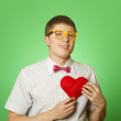 Smiling guy holding heart shape — Stock Photo