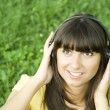 Young woman listening to music — Stock Photo #5835188