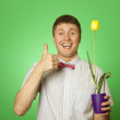 Man holding a tulip grown in a pot — Stock Photo
