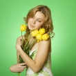 Happy Young Woman hugging a bouquet of tulips — Stock Photo