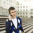 Modern student talking on a mobile phone — Stock Photo #5860698