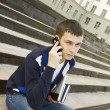Modern student talking on a mobile phone — Stock Photo #5860832