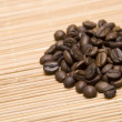 Close up of coffee beans in the heap - Stock Photo