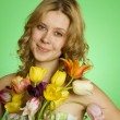 Happy Young Woman hugging a bouquet of tulips — Stock Photo #5910677