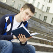 Male student on campus with textbooks — Stock Photo #5941782