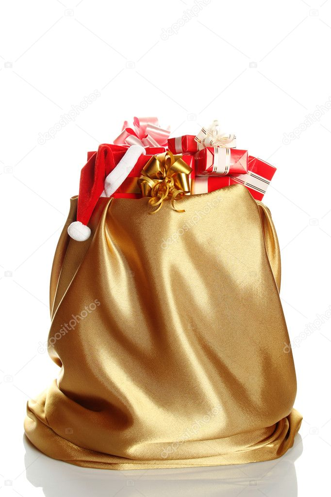Sack of gold color filled to the brim with Christmas gifts. At one gift Santa's wearing a cap. Isolated on a white background  Stock Photo #5955384