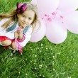Royalty-Free Stock Photo: Little Girl in the Park with pink balloons
