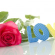 "Foto Stock: Red Rose and the text of ""LOVE"""