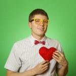 Smiling guy holding heart shape — Stock Photo