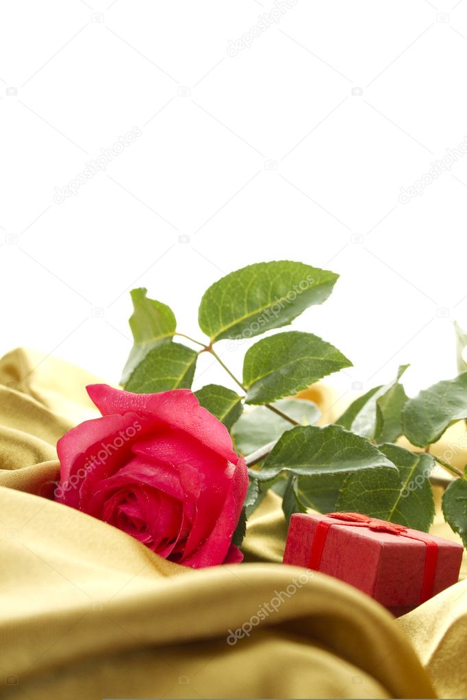 Close-up on the golden cloth red rose and a small red box. Marriage proposal. Postcard — Stock Photo #5998559