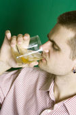 Close-up guy drinking an alcoholic beverage — Stock Photo