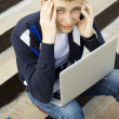 Young student working on a laptop — Stock Photo #6041440