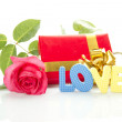Red Rose, gift box and the text LOVE — Stock Photo