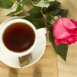 A cup of tea and rose — Stock Photo
