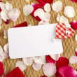 Royalty-Free Stock Photo: Card and rose petals