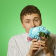 "Lover man ""nerd"" with a bouquet of flowers — Stock Photo"