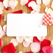 Stock Photo: Card and rose petals