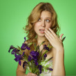 Attractive girl hugging a bouquet of Irises — Stock Photo