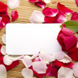 Card and roses — Stock Photo
