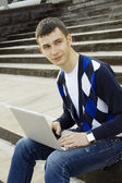 Young student working on a laptop — Stock Photo