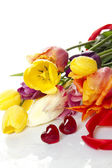 Tulips and two red hearts — Stock Photo