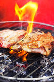 Meat on a grill — Stock Photo
