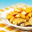 Stock Photo: Grilled chicken with potatoes on a plate