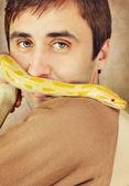 A man holding a pet python — Stock Photo