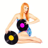 Redhead pinup holding records — Stock Photo