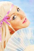 Beautiful blonde girl on blue background — Stock Photo