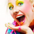 Studio shot of a blonde with colorful makeup - Stock Photo