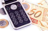 Mobile phone and money from Brazil — Stock Photo