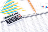 Financial chart, pen and calculator — Stock Photo