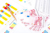 Financial chart, European money and pen — Stock Photo