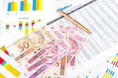 Financial chart and datasheet. Brazilian money and pen. — Stock Photo