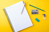 Copybook, pen, pencil and other equipment — Stock Photo