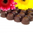 Flowers and chocolate — Stock Photo