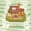 House on hundreds dollars — Stock Photo