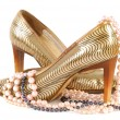 Womgolden shoe — Stock Photo #5885810