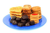 Chocolates and cookies — Stock Photo