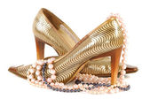 Woman golden shoe — Stock Photo