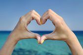 Love sea hand heart gesture — Stock Photo