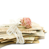 Stack of old love letters (1890-1910), lace and rose flower — Stock Photo