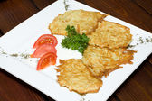 Crispy fried potato pancakes — Stock Photo
