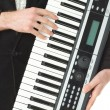 Music synthesizer in male hand — Stock Photo