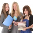 Young smiling students with books on white — Stock Photo